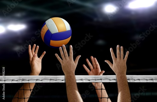 fototapeta na drzwi i meble Volleyball spike hand block over the net
