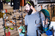 Man chooses professional climbing equipment