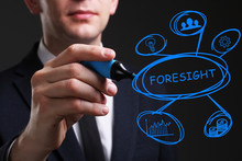 Business, Technology, Internet And Network Concept. Young Business Man Writing Word: Foresight