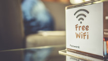 Free Wifi Signal Sign On Coffee Table.