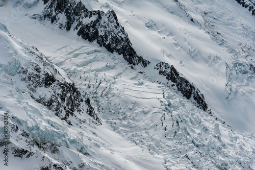 Fotografie, Obraz  Glacier des Bossons flowing down between mountain ridges in winter