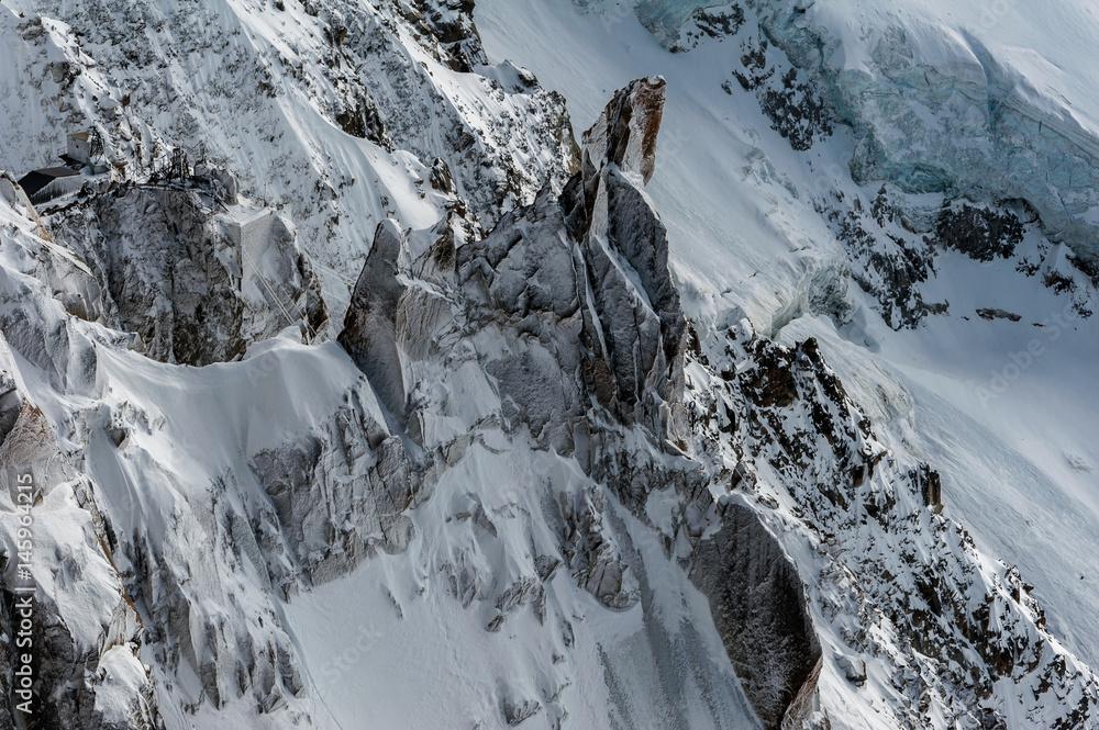 Fényképezés Snow covered cliffs and glacier crevasses in winter