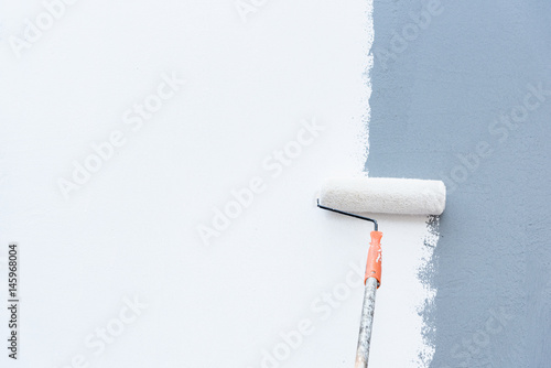 Fotomural  Roller Brush Painting, Worker painting on steel surface wall by the roller brush for protection and corrosion