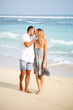 Beautiful Couple Walking and Kissing on Beach