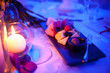 Leinwanddruck Bild - strawberries, blueberries on the table in the restaurant by candlelight
