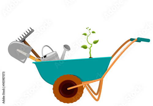 Photographie wheelbarrow with a shovel, a rake, a watering can and a sprout.