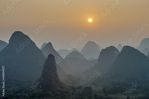 Foto op Canvas Guilin Foggy sunset. The view from the top of the Vine Mountains near Guilin - China