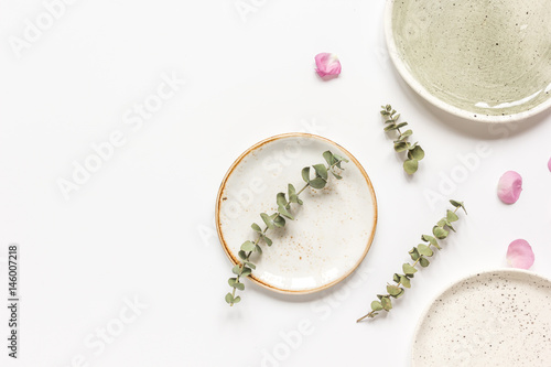 rose, eucalyptus and plates in spring design white background top view mockup © 279photo