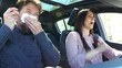 Man sneezing in car while wife is driving