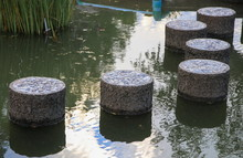 Stone Walkway Across The Pool In Public Park Select Focus With Shallow Depth Of Field.