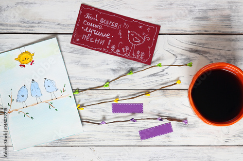 Orange bowl cup with coffee, card with three birds, postcard with