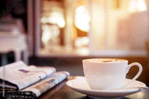 Fototapeta Cappuccino coffee cup on the table, warm tone  obraz
