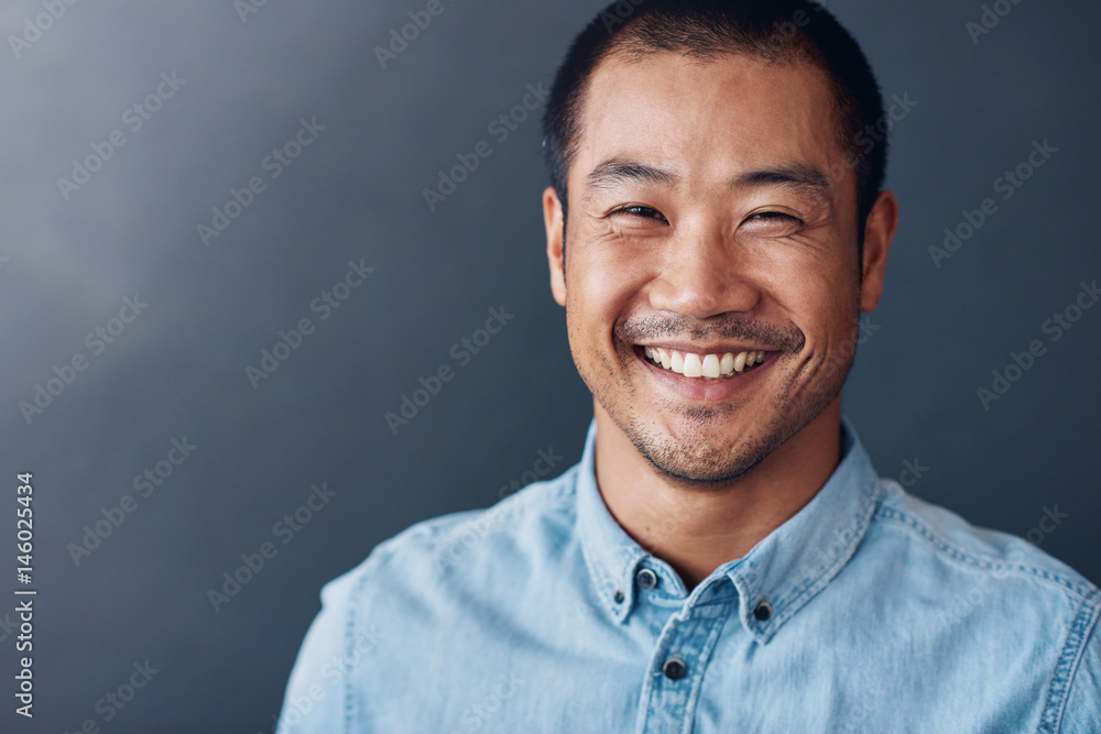 Fototapety, obrazy: Smiling young Asian designer standing in an office