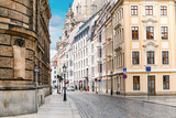 Fototapeta Uliczki - A narrow street in the historic center of Dresden in the morning without pedestrians and cars
