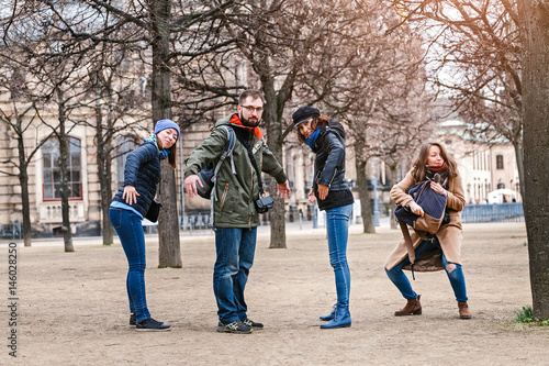 Group Of Young People Standing In Funny Poses Travel And Humor Photograph Concept