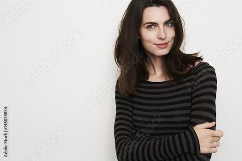 Photo  Beautiful brunette woman in stripes, portrait