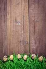 Horizontally Row Of An Eggs On A Grass On A Old Wooden Panel. Nature Cocept. Flat Lay.