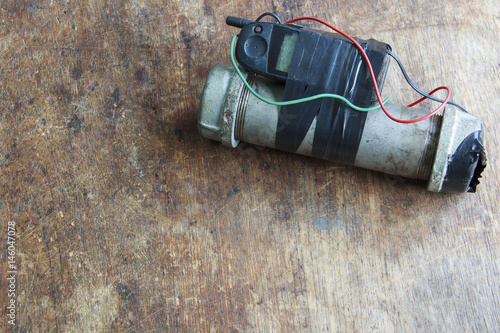 Fotografie, Obraz  Steel pipe explosive (IED) is ignited by cell phone.