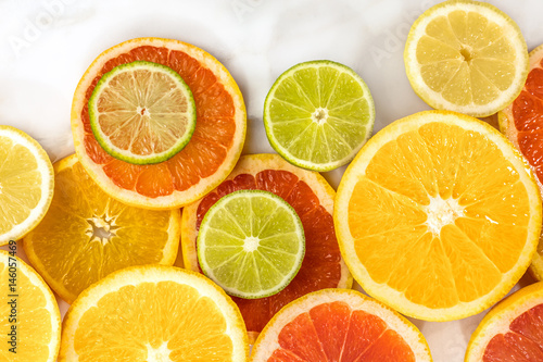 Photo Stands Slices of fruit Grapefruit, lime, lemon, and orange slices with copyspace