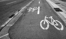 Bicycle Lane Sign On The Road, Symbol For Roadway Part Reserved For Cyclist Only