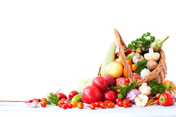 Basket with fresh vegetables and fruits.