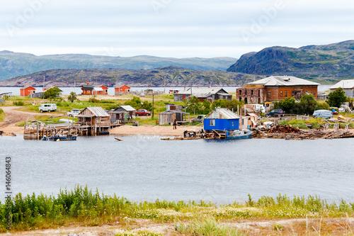Pinturas sobre lienzo  Teriberka, Kola Peninsula, Shore with parked fishermen's ships, some of the corpses sank