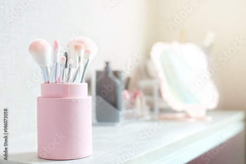 Pink brush set in package on cosmetic dressing table for makeup Wallpaper Mural