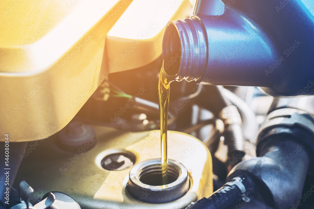 Fototapety, obrazy: Pouring oil to car engine, close up selective focus