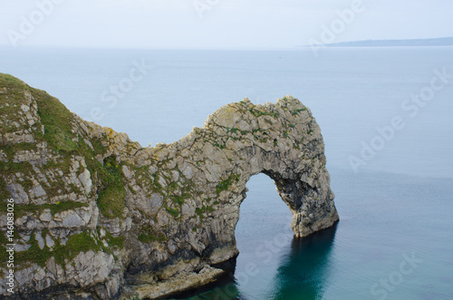 Durdle Door natural stone Arch with sea in background Poster