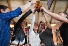 Cheerful Friends Toasting Beer...