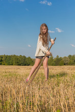 Teengirl With A Scythe At Summer Field