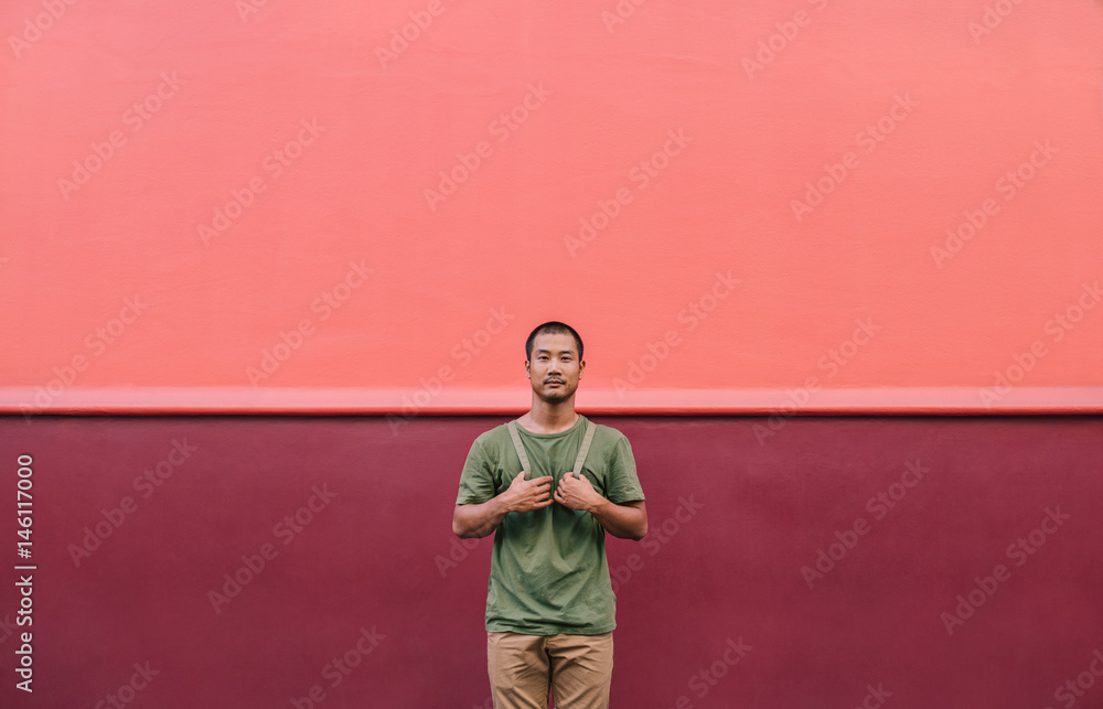 Fototapety, obrazy: Cool young Asian man standing on a colorful city street