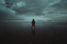 Lone Figure Facing Incoming Storm