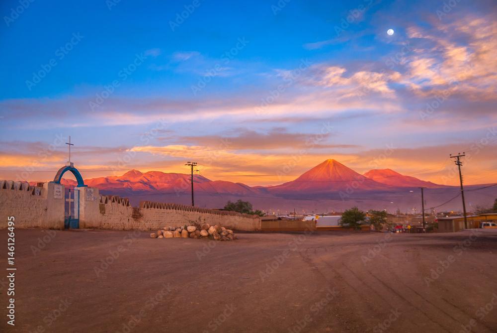 Andes with Licancabur volcano on the Bolivian border in the sunset at full moon, San Pedro de Atacama, Chile, South America
