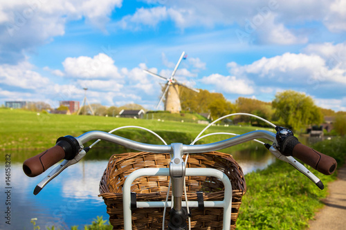 Obraz Bicycle and windmill. Symbols of the Netherlands. - fototapety do salonu
