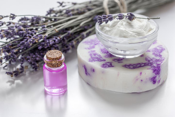 Obraz na płótnie Canvas natural herb cosmetic with lavender flowers flatlay on white background