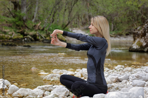 Fototapety, obrazy: Sport, fitness woman doing stretching exercises , relaxing in nature, breathing fresh air