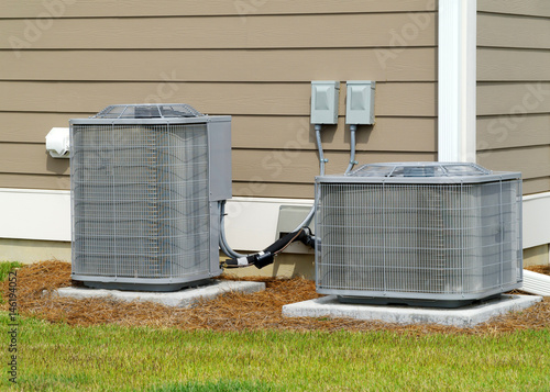 Photo A/C units connected to residential house