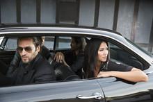 Friends Sitting In Shiny Sedan