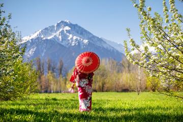 Fototapeta Woman in Japan costume at cherry blossom