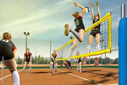Female volleyball players h...