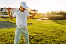 Golfer With Golf Club At Cours...