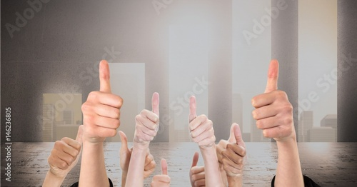 Valokuva  Digital composite image of hands gesturing thumbs up