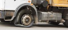 Flat Tire Of An Old Fragment Of A Rusty Broken Truck