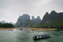 Li River And Karst Mountains / Hills In Yangshuo, Guangxi, China, One Of China's Most Popular Tourist Destinations.