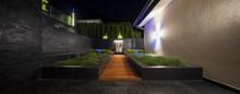 Zen Garden With A Fountain At Night