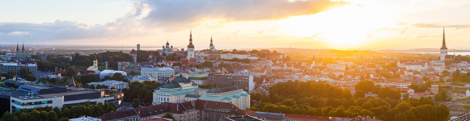 Colorful sunset over towers of old town of Tallinn, Estonia. Ultra wide panoramic view