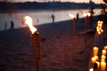 Bamboo Torches. Night Lit Torch On The Beach