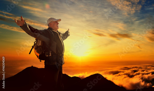 Fototapeta old senior man hiking successful on the top of the moutain obraz
