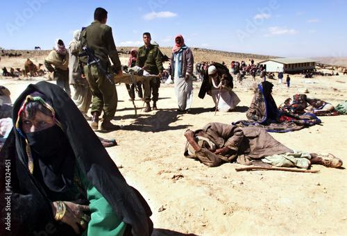 ISRAELI SOLDERS CARRY SICK BEDOUIN IN MAKESHIFT ENCAMPMENT